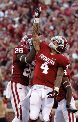 Photo - OU's Kenny Stills (4) reacts after scoring a touchdown during the college football game between the University of Oklahoma Sooners (OU) and the University of Kansas Jayhawks (KU) at Gaylord Family-Oklahoma Memorial Stadium on Saturday, Oct. 20th, 2012, in Norman, Okla. Photo by Chris Landsberger, The Oklahoman