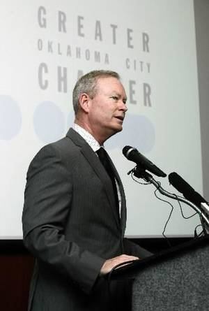 Photo - OKC Mayor Mick Cornett discusses a new series of jobs being offered by AT&T, during a press conference at the Oklahoma City Chamber of Commerce in Oklahoma City, OK, Thursday, June 27, 2013, Photo by Paul Hellstern,