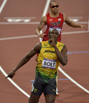 Photo - Jamaica's Usain Bolt celebrates as he crosses the finish line to win the men's 200-meter final during the athletics in the Olympic Stadium at the 2012 Summer Olympics, London, Thursday, Aug. 9, 2012. (AP Photo/Martin Meissner) <strong>Martin Meissner</strong>