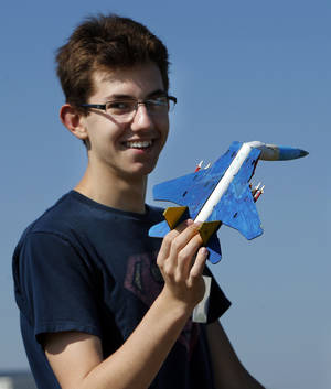 Photo -  Alex Konieczny, 16, recovers his handmade rocket during a session of Sooner Flight Academy. Photo by Steve Sisney, The Oklahoman  <strong>   -   </strong>