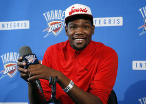 Photo - Oklahoma City Thunder forward Kevin Durant smiles during an NBA basketball news conference in Oklahoma City, Thursday, May 16, 2013. Torpedoed by an injury to All-Star point guard Russell Westbrook, the Thunder's season is over far sooner than expected. After making it to the NBA Finals last season, Oklahoma City couldn't make it out of the second round this year with Westbrook sidelined.(AP Photo/Sue Ogrocki) ORG XMIT: OKSO105