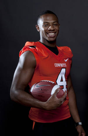 Photo - Oklahoma State's Justin Gilbert is one of the fastest players in the Big 12, and the new kickoff rule is unlikely to slow him down. Photo by Sarah Phipps, The Oklahoman Archives
