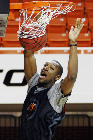 photo - Oklahoma State forward Kamari Murphy shoots during practice following an NCAA college basketball media day in Stillwater, Okla., Monday, Oct. 22, 2012. (AP Photo/Sue Ogrocki) ORG XMIT: OKSO106