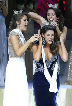 Photo - Miss Oklahoma 2014 Alexandra Eppler, foreground, from Enid, is crowned by Miss Oklahoma Outstanding Teen Joei Whisenant, left, and Miss Oklahoma 2013 Kelsey Griswold. <cutline_credit_leadin>PhotoS by James Gibbard, Tulsa World</cutline_credit_leadin> <strong>JAMES GIBBARD</strong>