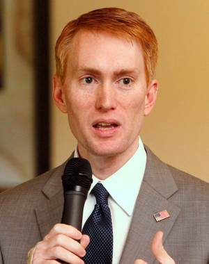 Photo - Congressman James Lankford speaks to the Edmond Chamber of Commerce during a luncheon at Oak Tree Country Club in Edmond, OK, Tuesday, April 19, 2011. By Paul Hellstern, The Oklahoman