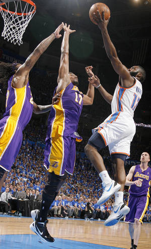 Photo - Oklahoma City's James Harden (13) goes to the basket beside Los Angeles' Andrew Bynum (17) and Los Angeles' Jordan Hill (27) during Game 1 in the second round of the NBA playoffs between the Oklahoma City Thunder and the L.A. Lakers at Chesapeake Energy Arena in Oklahoma City, Monday, May 14, 2012. Photo by Sarah Phipps, The Oklahoman