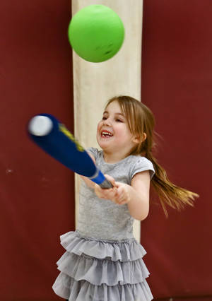 Photo -  Harper LeForce takes a swing at a ball as she plays Tuesday in the gym at Belle Isle Enterprise Middle School. Photo by Chris Landsberger, The Oklahoman  <strong>CHRIS LANDSBERGER -   </strong>