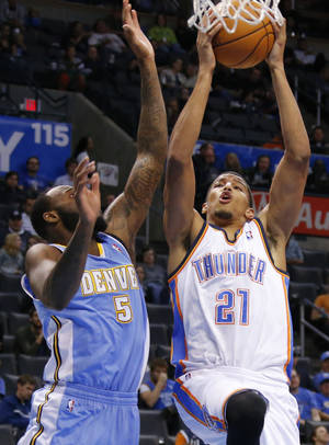 Photo - Oklahoma City 's Andre Roberson (21) drives beside Denver's Damion James (5) during an NBA preseason game between the Oklahoma City Thunder and the Denver Nuggets at Chesapeake Energy Arena on Tuesday, october 15, 2013. Tuesday, Oct. 15, 2013. Photo by Bryan Terry, The Oklahoman