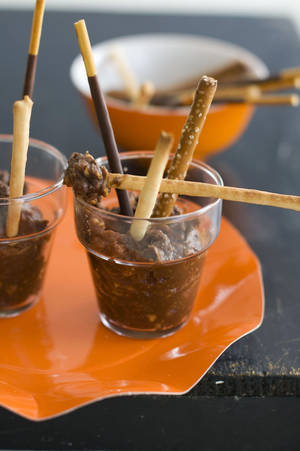 photo - This Halloween party dish is called Pots of Mud. <strong>Matthew Mead - AP</strong>