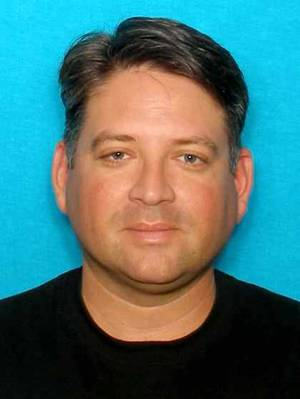 Photo - This undated image provided by the Whitefish, Mont., Police Department shows TV personality, Gregory Rodriguez who was shot and killed by Wayne Bengston, while Rodriguez was visiting Bengston's wife. Bengston later committed suicide.(AP Photo/Whitefish Police Department)