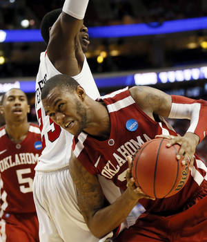 Photo - Oklahoma's Amath M'Baye (22) tries to get past San Diego State's DeShawn Stephens (23) during a game between the University of Oklahoma and San Diego State in the second round of the NCAA men's college basketball tournament at the Wells Fargo Center in Philadelphia, Friday, March 22, 2013. San Diego State beat OU, 70-55. Photo by Nate Billings, The Oklahoman