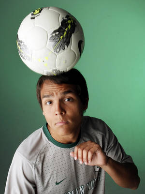 Photo - HIGH SCHOOL SOCCER: Brandon Little Axe of Norman North, All-City Boys Soccer Player of the Year, poses for a photo at the OPUBCO Studio in Oklahoma City, Wednesday, May 30, 2012.  Photo by Nate Billings, The Oklahoman