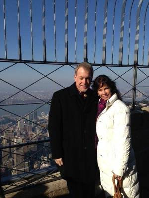 Photo - OSU assistant Glenn Spencer and ESPN's Jeannine Edwards atop the Empire State Building. Photo provided