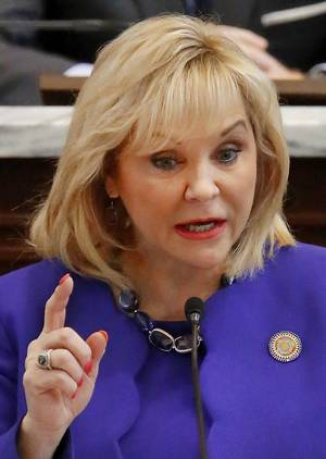 Photo - Gov. Mary Fallin has called for increasing education funding and cutting Oklahoma's income tax by a quarter-point.                    Photo by Jim Beckel,