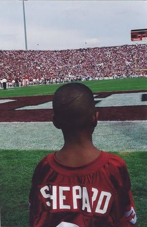 photo - Sterling Shepard at a Sept. 23, 2000, game against Rice during which the 1985 Oklahoma championship team was honored. Sterling&#039;s father, Derrick Shepard, played on the 1985 team. PHOTO  PROVIDED