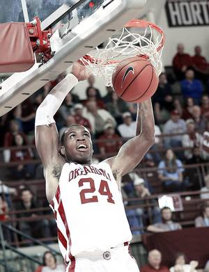 Photo - OU's Buddy Hield scored 29 points in Monday's exhibition victory against Oklahoma Christian at McCasland Field House. Photo by Steve Sisney, The Oklahoman