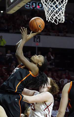 Photo - Oklahoma State's Toni Young (15) shoots in front of Oklahoma's Joanna McFarland (53) during the women's Bedlam basketball game between Oklahoma State University and Oklahoma at the Lloyd Noble Center in Norman, Okla., Sunday, Feb. 10, 2013.Photo by Sarah Phipps, The Oklahoman