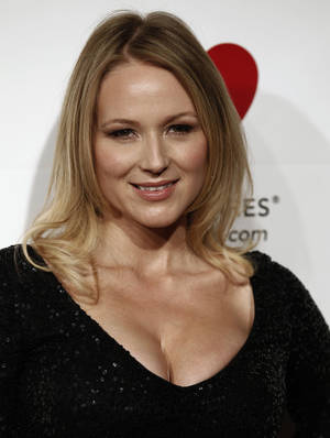 "Photo -   FILE - In this Feb. 11, 2011 file photo, Jewel arrives at the MusiCares Person of the Year gala honoring Barbra Streisand in Los Angeles. Jewel's latest song, ""Flower,"" was written to raise awareness about the importance of breast reconstruction options for breast cancer survivors. The singer is heading to New Orleans next month to perform ""Flower"" and other hits at a benefit concert championing the cause. (AP Photo/Matt Sayles, file)"