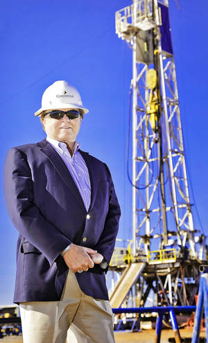 Photo - Continental Resources' Chairman and Chief Executive Officer Harold G. Hamm stands at a rig site Oct. 19 near Chickasha.
