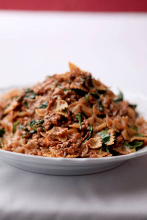 photo - Farfalle Abruzzese with veal, porcini and spinach is a deeply flavored comfort dish.   MCT Photo