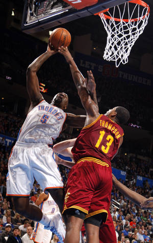 photo - Oklahoma City's Kendrick Perkins (5) shoots a basket as Cleveland's Tristan Thompson (13) defends during the NBA basketball game between the Oklahoma City Thunder and the Cleveland Cavaliers at the Chesapeake Energy Arena, Sunday, Nov. 11, 2012. Photo by Sarah Phipps, The Oklahoman