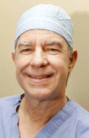photo - Dr. Keith Clark regularly performs tonsillectomies.