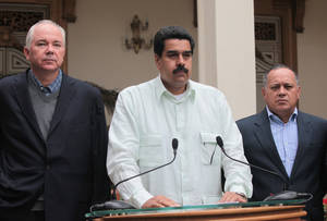 "photo - In this photo released by Miraflores Press Office, Venezuela's Vice President Nicolas Maduro, center, addresses the nation on live television flanked by Oil Minister Rafael Ramirez, left, and National Assembly President Diosdado Cabello at the Miraflores presidential palace in Caracas, Venezuela, Wednesday, Dec. 12, 2012.  Maduro said that Venezuela's President Hugo Chavez will face a ""complex and hard"" process after undergoing his fourth cancer-related operation in Cuba on Tuesday. Over the weekend, Chavez named Maduro as his chosen political heir. (AP Photo/Miraflores Press Office, Efrain Gonzalez)"