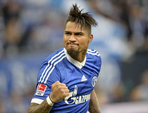 Photo - Schalke's Kevin-Prince Boateng of Ghana celebrates after the opening goal during the German Bundesliga soccer match between FC Schalke 04 and VfL Wolfsburg in Gelsenkirchen,  Germany, Saturday, Feb. 1, 2014. (AP Photo/Martin Meissner)