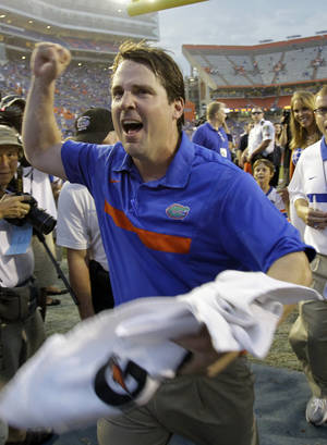 Photo - Florida head coach Will Muschamp celebrates after defeating Tennessee 33-23 in an NCAA college football game Saturday, Sept. 17, 2011, in Gainesville, Fla. (AP Photo/John Raoux)  ORG XMIT: GVP112