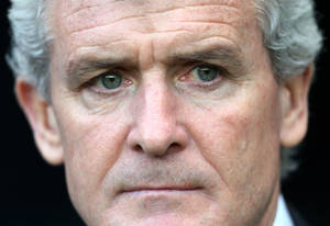 Photo - Stoke City's manager Mark Hughes looks on ahead of their English Premier League soccer match against Newcastle United at St James' Park, Newcastle, England, Thursday, Dec. 26, 2013. (AP Photo/Scott Heppell)