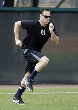 Photo - FILE - In this May 6, 2013, file photo, New York Yankees first baseman Mark Teixeira runs sprints during a rehab workout at the Yankees' Minor League Complex in Tampa, Fla. Teixeira started baseball workouts on Sunday, Feb. 16, 2014, four days ahead of the other position players. (AP Photo/Chris O'Meara, File)