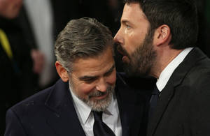 Photo - George Clooney, left, and Ben Affleck arrive for the BAFTA Film Awards at the Royal Opera House on Sunday, Feb. 10, 2013, in London. (Photo by Ki Price/Invision/AP)