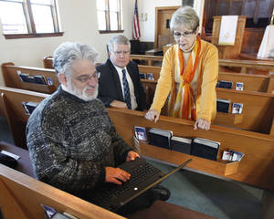 Photo - Steve Goldman, who works as a certified navigator to help Oklahomans buy health insurance under the Affordable Care Act, demonstrates the healthcare.gov online marketplace to Don Vaught and Bertha M. Potts, ministers with the First United Methodist Church of Edmond. Photo by Paul Hellstern, The Oklahoman <strong>PAUL HELLSTERN</strong>