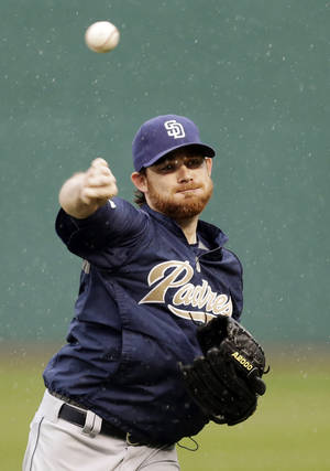 Photo - San Diego Padres starting pitcher Ian Kennedy throws in the rain at Progressive Field in Cleveland, Monday, April 7, 2014. The baseball game between the Padres and Cleveland Indians was postponed due to rain. (AP Photo/Mark Duncan)