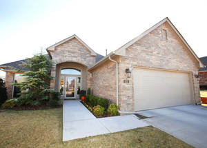 Photo - Ron and Vivian Waddell's home is in Touchmark at Coffee Creek, a gated neighborhood near Kelly Avenue and Covell Road in Edmond.