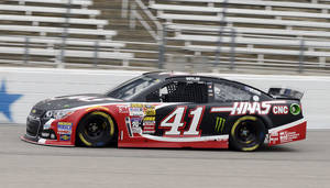 Photo - Kurt Busch makes a turn during a practice session for the NASCAR Sprint Cup Series auto race at Texas Motor Speedway in Fort Worth, Texas, Saturday, April 5, 2014. (AP Photo/LM Otero)