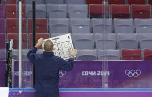 Photo - USA men's ice hockey coach Dan Bylsma posts up a diagram for the team during a training session at the 2014 Winter Olympics, Monday, Feb. 10, 2014, in Sochi, Russia. (AP Photo/Julie Jacobson)