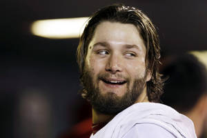Photo -   St. Louis Cardinals starting pitcher Lance Lynn smiles in the dugout after being pulled out of a baseball game during the seventh inning against the Houston Astros, Wednesday, Sept. 19, 2012, in St. Louis. The Cardinals won 5-0. (AP Photo/Jeff Roberson)