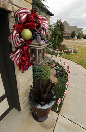 Photo - The outside of Mike and Debbie McCurdy's home is decorated for Christmas. The home is one of five on the Assistance League of Norman's annual Holiday Home Tour. PHOTO BY STEVE SISNEY, THE OKLAHOMAN <strong>STEVE SISNEY</strong>