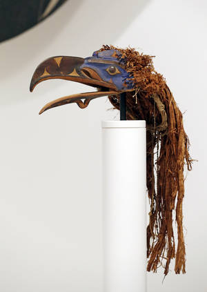 "Photo - A Nuxalk raven forehead mask that is part of a wager between Super Bowl cities is displayed as part of the Seattle Art Museum's Northwest Coast Native American art collection, Monday, Jan. 27, 2014, in Seattle. The directors of the art museums in the Super Bowl cities of Seattle and Denver have put up iconic statues in a wager on the NFL championship. If the Seattle Seahawks were to win, Christoph Heinrich, director of the Denver Art Museum, will send a Frederic Remington bronze of a cowboy on a bucking bronco to Seattle for three months. Kimerly Rorschach, of the Seattle museum, said that if the Denver Broncos win, Rorschach will send the carved Native American mask reminiscent of a ""Seahawk,"" embellished in black, blue and red paint, to Denver for three months. (AP Photo/Elaine Thompson)"