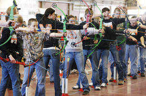 "Photo - Students participating in a regional ""Oklahoma Archery In The Schools"" shoot at State Fair Park in Oklahoma City Thursday, Feb. 14, 2013. Photo by Paul B. Southerland, The Oklahoman"
