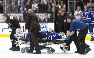 Photo - Toronto Maple Leafs' Paul Ranger is taken off the ice on a stretcher after hitting the boards head first from a check by Tampa Bay Lightning's Alex Killorn during first period NHL action in Toronto on Wednesday March 19, 2014. (AP Photo/The Canadian Press, Frank Gunn)