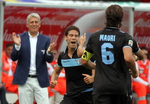 Photo -   Lazio Brazilian midfielder Hernanes, center, celebrates after scoring during a Serie A soccer match against Chievo at the Bentegodi stadium in Verona, Italy, Sunday, Sept. 16, 2012. (AP Photo/Felice Calabro')