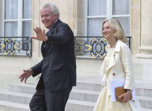 Photo - General Electric Co. CEO Jeffrey R. Immelt, left, and GE France chairwoman Clara Gaymard leave the Elysee Palace after a meeting with French President Francois Hollande at the Elysee Palace, Friday, June 20, 2014. The international race to take over France's engineering company Alstom SA entered its final stretch on Friday, with Siemens and Mitsubishi Heavy Industries responding to General Electric Co.'s sweetened bid by raising their own combined offer. (AP Photo/Michel Euler)