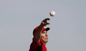 Photo - Cincinnati Reds pitcher Homer Bailey throws during spring training baseball practice in Goodyear, Ariz., Tuesday, Feb. 18, 2014. (AP Photo/Paul Sancya)