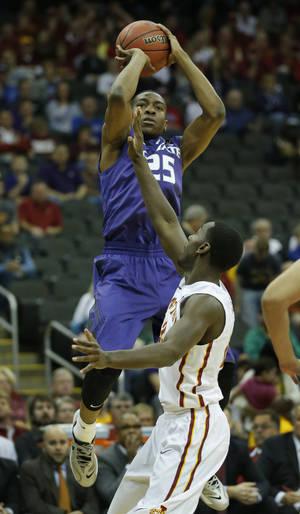 Photo - Kansas State guard Wesley Iwundu (25) shoots over Iowa State forward Dustin Hogue (22) during the first half during the first half of an NCAA college basketball game in the quarterfinals of the Big 12 Conference men's tournament in Kansas City, Mo., Thursday, March 13, 2014. (AP Photo/Orlin Wagner)