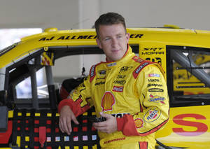Photo -   In this Feb. 18, 2012, photo, AJ Allmendinger leans against his car in the garage area during NASCAR Daytona 500 practice at Daytona International Speedway in Daytona Beach, Fla. NASCAR has temporarily suspended Allmendinger after he failed a drug test. Allmendinger won't be allowed to drive Saturday night, July 7, in the Sprint Cup race at Daytona. Instead, Sam Hornish Jr. will be behind the wheel of the No. 22 Dodge for Penske Racing. Allmendinger has 72 hours to request that his B sample be tested. (AP Photo/Phelan M. Ebenhack)