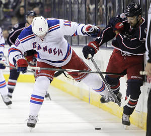 Photo - New York Rangers' JT Miller, left, collides with Columbus Blue Jackets' Nick Foligno during the second period of an NHL hockey game Thursday, Nov. 7, 2013, in Columbus, Ohio. (AP Photo/Jay LaPrete)