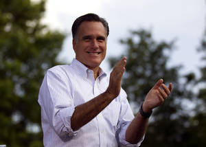 Photo -   Republican presidential candidate, former Massachusetts Gov. Mitt Romney applauds during a campaign stop at Cornwall Iron Furnace on Saturday, June 16, 2012, in Cornwall, Pa. (AP Photo/Evan Vucci)