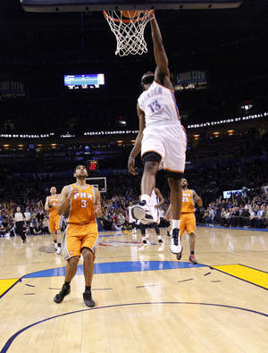 Photo - Oklahoma City's James Harden (13) dunks in front of Phoenix's Jared Dudley (3) during overtime of the NBA game between the Oklahoma City Thunder and the Phoenix Suns, Sunday, March 6, 2011, the Oklahoma City Arena. Photo by Sarah Phipps, The Oklahoman.